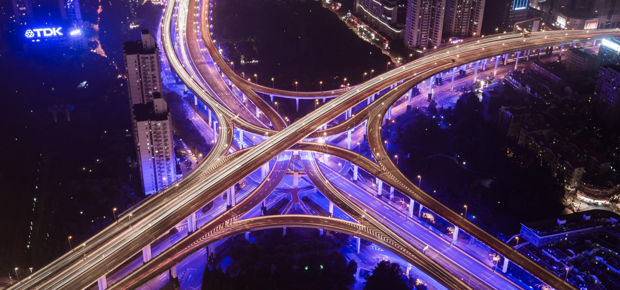 Two highway crossing, with intersections going between each other, at night, with a beautiful blue light