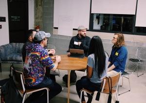 People sitting a circular table talking